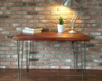 Industrial handcrafted desk with reclaimed wood and steel hairpin legs.