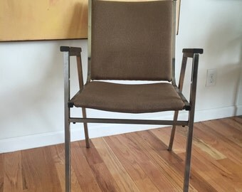 Mid century modern metal chair with wooden arms