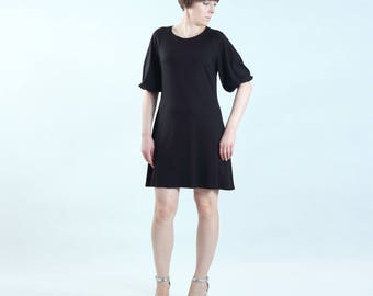 comfortable black jersey tunic or dress with short gathered sleeves made of soft fabric thigh length