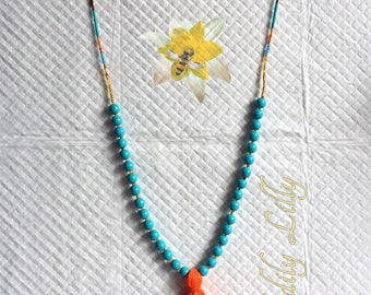 Turquoise and Orange Tassel necklace