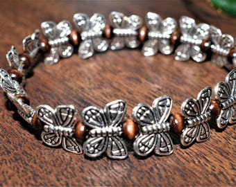antique silver butterfly with wood beads