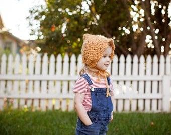 Crochet Baby Girl Bonnet with Mustard Yellow Alpaca Yarn in a Soft Shell Stitch