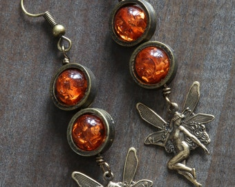 Steampunk Earrings - Amber colored beads and woodland fairy charm
