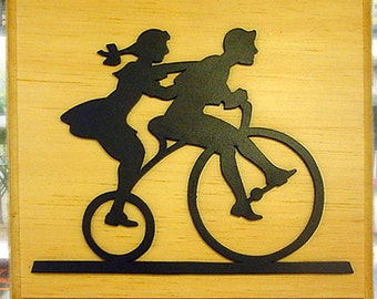 Two Children on a Tricycle Wood Wall Hanging