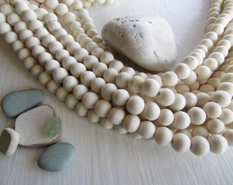 White round wood beads , bleached , off white yellowish cream tone , Philippines, boho Natural exotic 10-11mm ( 40 beads  ) 6PH29