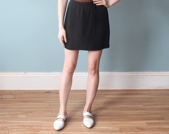 black mini skirt | 90s united colors of benetton cotton skirt | small