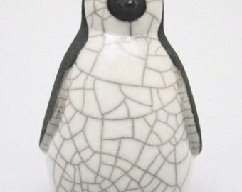 Penguin chick resting - ceramic raku fired sculpture