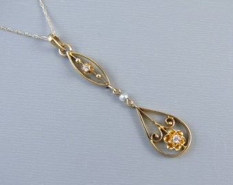 Antique Edwardian 14k gold two diamond and seed pearl buttercup setting lavalier pendant necklace