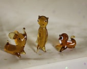 Three amber color blown glass figurines Very small but wonderful to display Perfect condition Elephant Marmot Doggie miniatures
