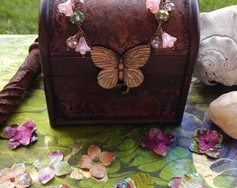 Ornately Detailed Butterfly with Vintage Pink German Glass Flowers and Pink and Green Crystals Necklace