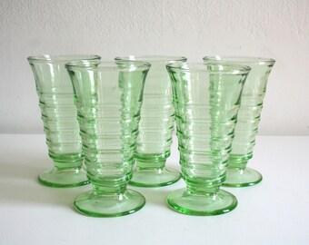 Five Vaseline Footed Glasses