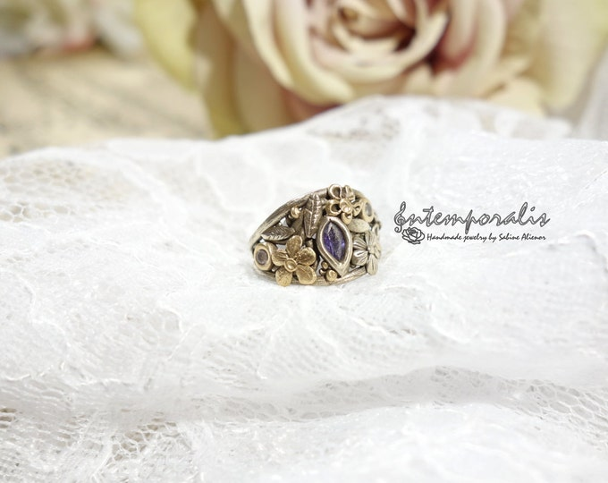 White bronze, silver color, ring decorated with gold bronze flowers and leaves and purlpe cubic zirconium, french size 51, OOAK, SABA43