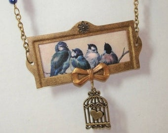 Vintage Assemblage Necklace - Bird Necklace - Blue Bird Image in vintage file label frame - Deep blue beads -One of a kind -Upcycled Jewelry