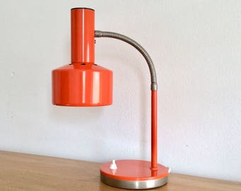 Orange mid-century modern gooseneck desk lamp or table lamp with round orange metal and chrome base
