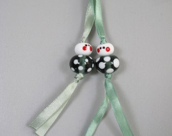 Valentines gift: pair of lucky charms - transparent steel green/ white polka dots - handmade glass beads - free postcard