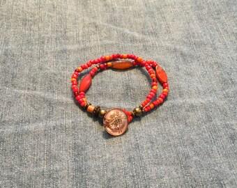 Double Strand Orange Beaded Bracelet