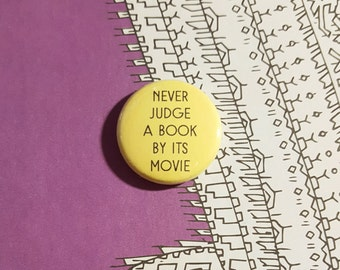 Never Judge a Book By its Movie Pinback Button or Magnet