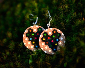 Ring shape earrings with heart made of colored pencils