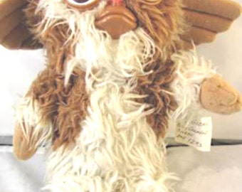"""Classic Gizmo soft furry doll with squeaker from the Movie """"Gremlins"""". This doll comes from the mega hit movie """"The Gremlins"""""""