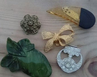 Lot of four old dress clips and a buckle