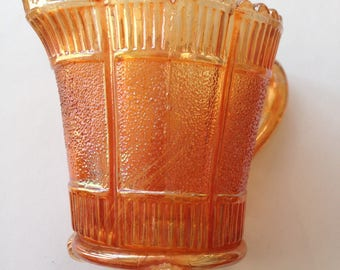 Gorgeous vintage peach iridescent lustre carnival glass creamer jug with three feet