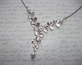 Silver orchid flower cascade necklace with pearls