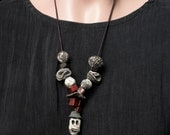 Night in New Orleans, long necklace with skull pendant, a rustic sautoir with raw ceramics and leather cord, red white and black