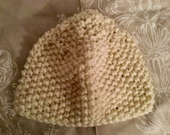 Hand knitted cream, wooly hat. Beanie style.