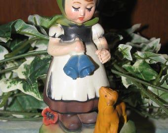 Vintage hard plastic girl with dog figurine