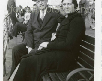 Vintage Photo,  Black & White Photo, Elegant Man and Woman in Great Hats Sitting on Bench on a Boardwalk, Old Photo, Found Photo, 1930's