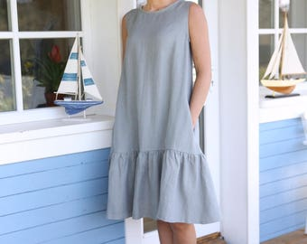 Wide sleeveless linen dress with pleated skirt. Handmade linen tunica. Loose summer dress with side pockets and belt.