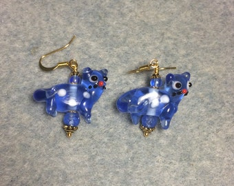 Translucent blue lampwork cat bead dangle earrings adorned with blue Czech glass beads.