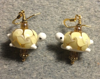 Amber lampwork turtle bead earrings adorned with amber Czech glass beads.