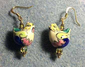Green, pink, yellow and blue ceramic chicken bead earrings adorned with green Czech glass beads.