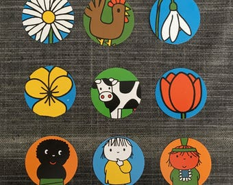 9 cardboard circles with prints made by Dick Bruna