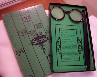 Seemour magnifying glasses,glasses with handle,mock tortoise shell finish,original box,green & black graphics,vision