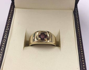 14ct Yellow Gold Signet style ring with an Amethyst Stone in the centre