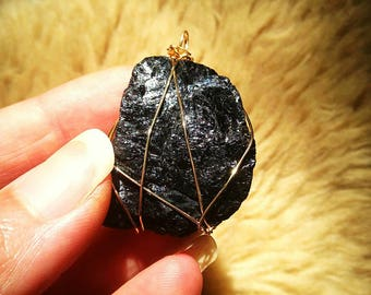 Black Tourmaline Wrapped in gold colored Wire