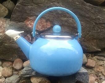 Vintage blue tea kettle with bird whistle