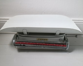 Vintage scale of the brand bar