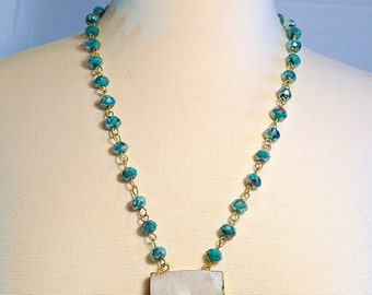 Teal blue green faceted wire wrapped necklace with white druzy pendant