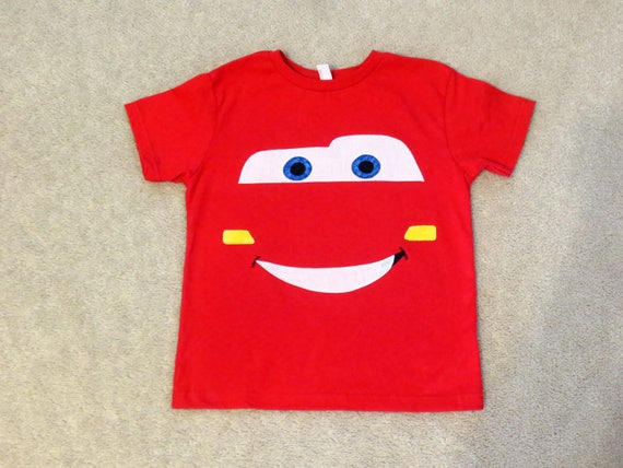 More on Cars Toddler Boys Lightning McQueen Costume: Hit the tracks in this red-hot Cars costume for toddler boys. Inspired by the racecar Lightning McQueen, this padded pit crew costume features McQueen's number