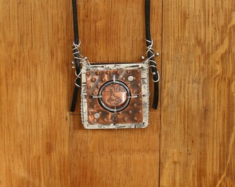I See You - copper and sterling silver pieces that have been etched, punched, riveted and wired.