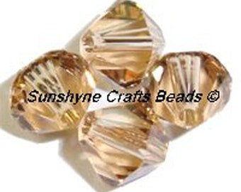 Swarovski Crystal Beads 5301/5328  LIGHT COLORADO TOPAZ Xilion Faceted Bicone Beads - Sizes 3mm, 4mm & 6mm available