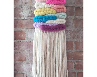 Wooly rainbow weaving, woven wall hanging