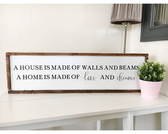A house is made of walls and beams, a home is made of love and dreams sign//wood sign