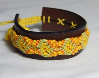 Brazilian yellow and pale green bracelet on a leather thong