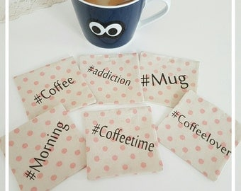 6 saucers with hastags coffee themed designs