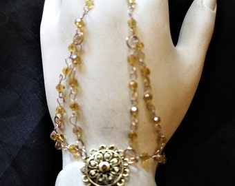 Gold metal slave bracelet with charm