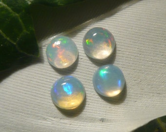 Set of Welo Opal Cabochons, 0.6ct total